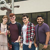 Macee Sampson (left), Austin Nylander, Sergio Elizondo and Cory Deleon gather for a portrait outside of the center for arts building.