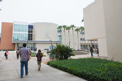 Students make their way across campus on a cloudy first day of class.