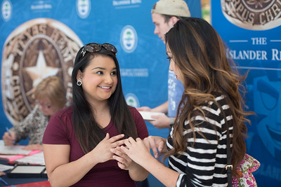 Raven Trevino (left) and Ashley Garcia try on rings during the islander ring sale in the university center.