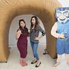 Raven Trevino (left) and Ashley Garcia take a photo in front of the islander inflatable ring.