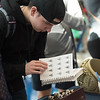 Williams Abruzzes looks through a catalog of rings during the islander ring sale in the university center.