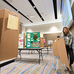 Ingrid Fernandez makes her way through the university center's ballroom to set up a poster board for the Coastal Bend Regional Science Fair.