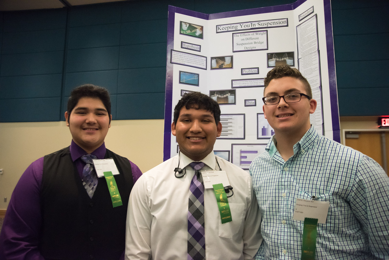 (left to right) Ismel Olivarez )16) Jesse Molina (16) and Jace Hinojosa (15) stand in front of their project at the regional science fair on Saturday, January 28, 2017 at the University Cent ...