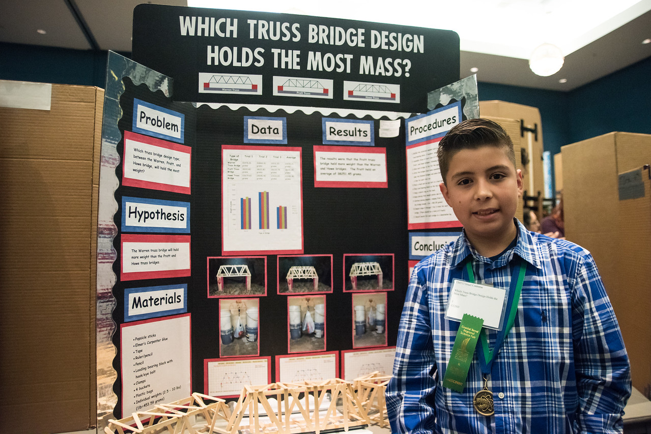 Isreael Conteras (12)  stands in front of his project at the regional science fair on Saturday, January 28, 2017.