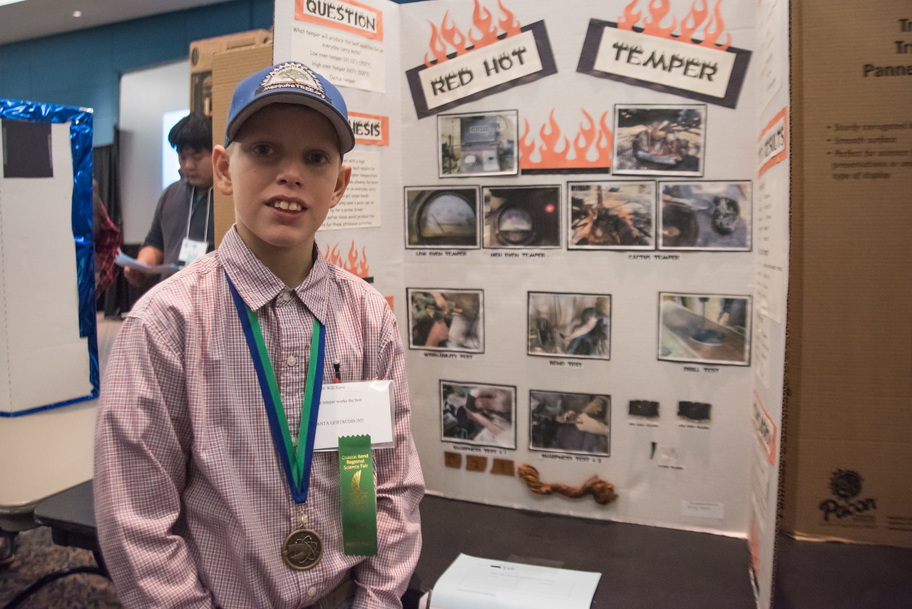 Will Nave (12) stands in front of his project Red Hot Temper at the regional science fair on Saturday, January, 29, 2017.