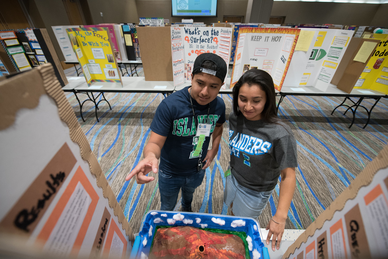 Student volunteers Roberto Flores and Marisabel Serna take a look at the poster boards set up in the university center.