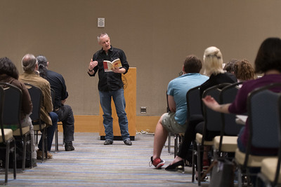 Award winning poet Nathan Brown reads lines from his book during University Author's Day.