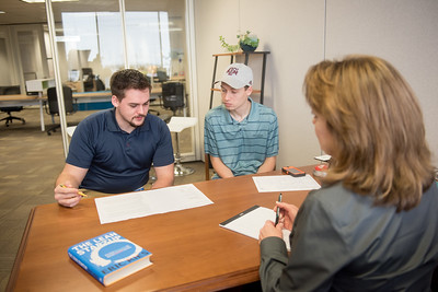 College of Business students Landon O'Neal (left) and Payton Drake review Tax Time Services business at the Coastal Bend Business Innovation Center as part of their course.