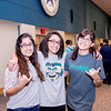 TAMU-CC students Alisa Cofresi(left), Clarimar Troche(middle) and Lauren Garcia(right) show their Islander Spirt for Homecoming with smiles and shakas.