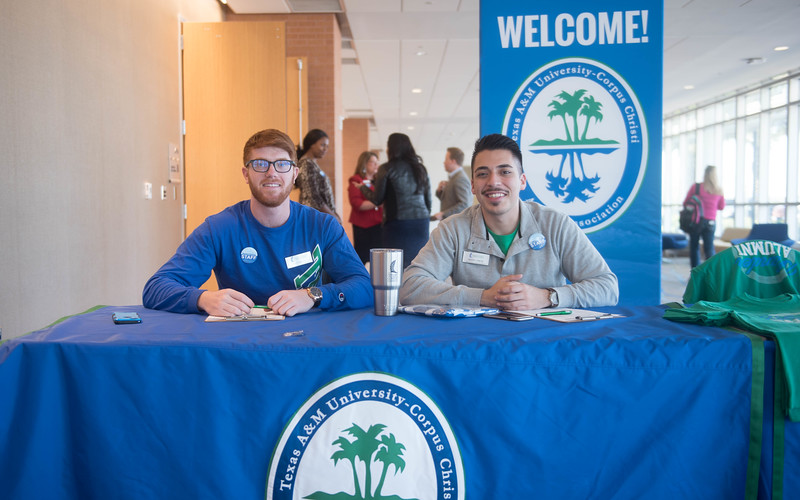 TAMUCC Students Scott Kelly(left) and Frank Garcia(Right) welcome attendees to the faculty alumni luncheon during Homecoming week.