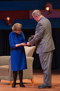 Guest speaker Dr. Sylvia Earle receives a shark plaque from Dr. Larry McKinney. The plaque represents a shark tagged and named after Sylvia Earl.