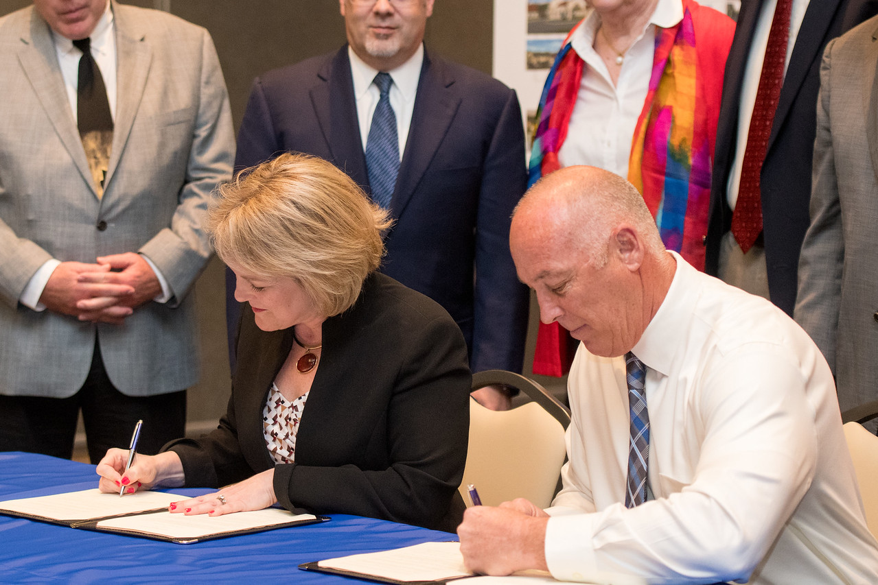 Interim President Dr. Kelly Quintanilla and Robert Johnson during the MOA Signing Wednesday March 22 at TAMU-CC.