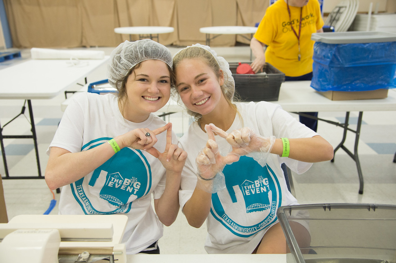 Student volunteers Abbey Bennet and Tegan Saenz take a moment to smile for a quick photo.