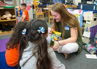 Student Jeniya Fuwkes reads to 3rd grade students in the Early Childhood Development Center.