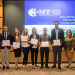 Participants of the Three Minute Thesis gather for a group photo after their presentations.