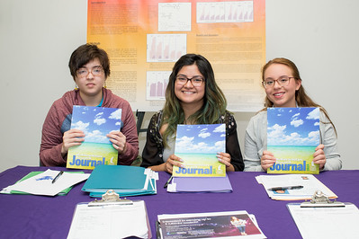 Zoe Ramos (left), Elisa Silva, and Michelle McGaha pause for a photo during the McNair Journal Signing event in the Mary and Jeff Bell Library.