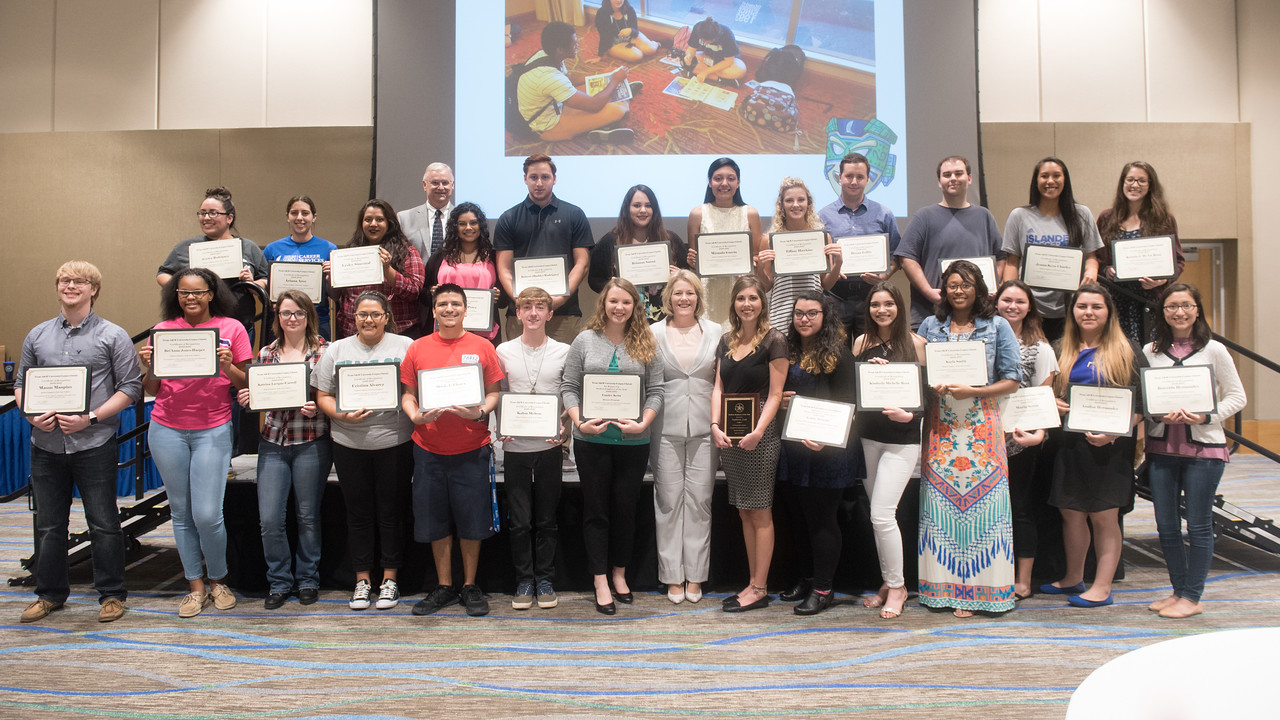 Student workers gather for a group photo following the Student Employee of the Year Reception.