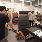 Haiyong Zheng (left), and Prayoga bring in tires modified to protect the BUV during transport.