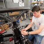 TAMU-CC student Corey Funk works on the BUV project in the engineering lab.
