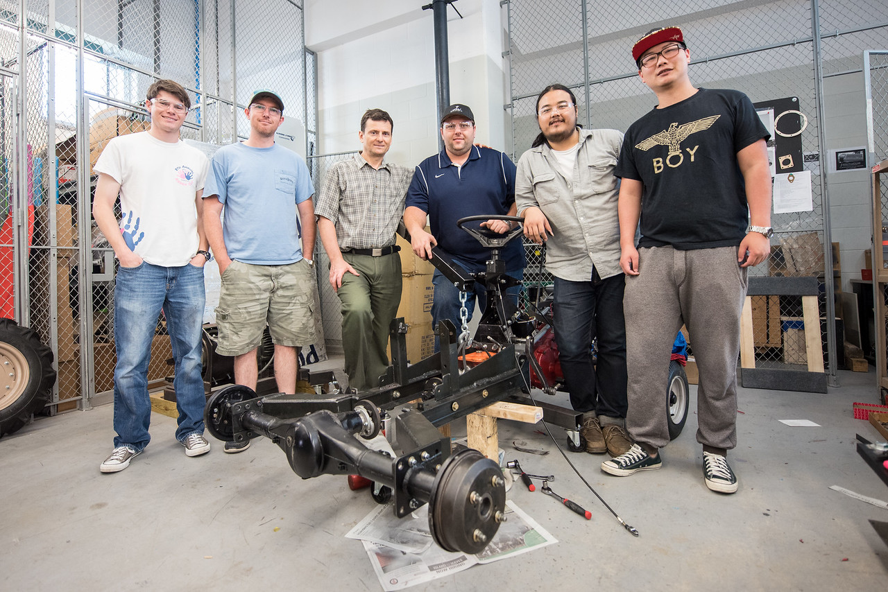 Corey Funk (left), Sterling Smith, Dr. Simionescu, Josh Houston, Prayoga, and Haiyong Zheng [pose with their Basic Utility Vehicle (BUV) for their upcoming BUV competition in Batavia, Ohio.