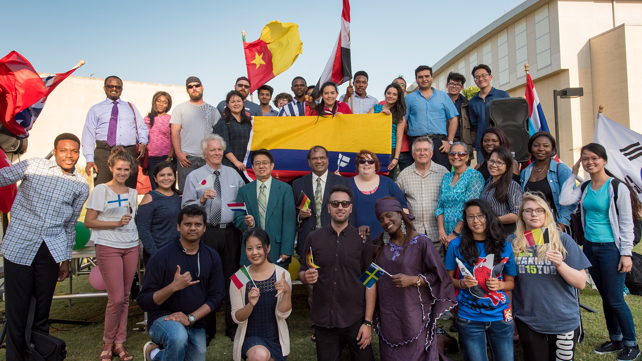 Students and faculty pose for a group photo following the Parade of Nations event.