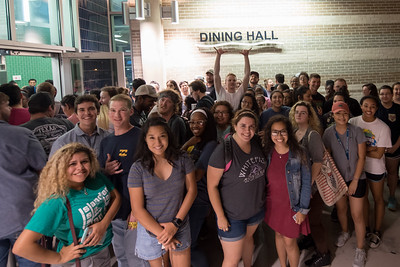 Students gather for a group photo as they make their way into the Dining Hall for the Late Night Breakfast event.