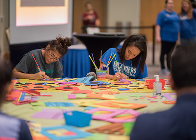 Brennan Morgan (left) and Kayleigh Movalli create foam frames during the Paws on the Island event.