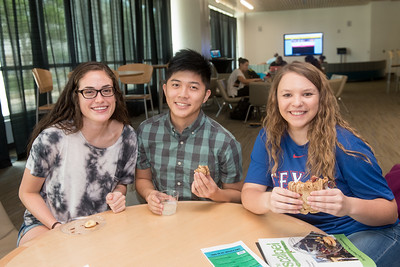 Breanna Poses (left), Brandon Phung, and Emalee Keim enjoy peanut butter and jelly sandwiches in the UC Tejas Lounge at the Extreme PB&J event hosted during Finals Week.