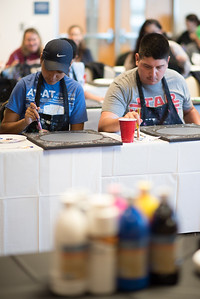 "Miranda Garcia (left) and Ted Gonzalez take part in Project GRAD'S ""May the 4th Be With You"" Painting Party, one of many events being held on campus to help students relax during final exams."