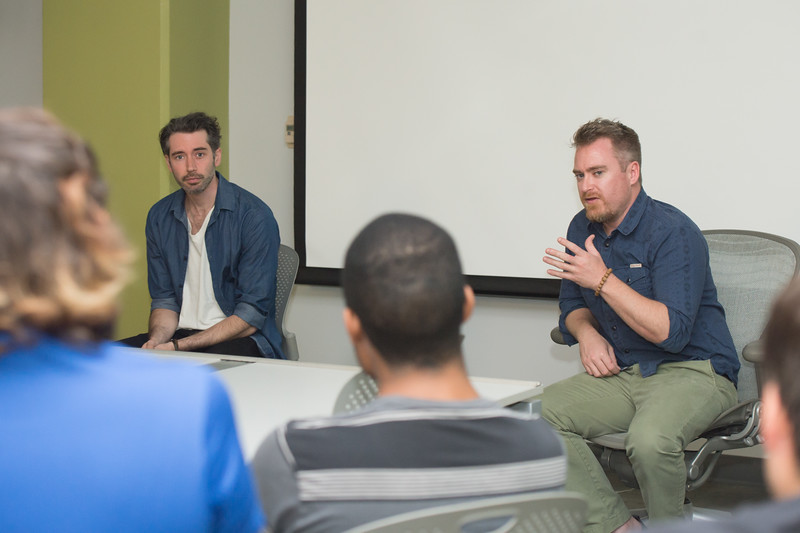 """Actor Andrew Pastides (left) and video production professor Nick Manley discuss the topic of working as actors and directors during South Texas Cinémathèque's screening of the film """"MA"""" at the Art Museum of South Texas."""