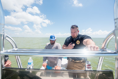 Captain Todd Grubert (left), and Port Mansfield police department's LT of special operations Brian Vickers communicate with the Lone Star UAS ground team during the UTM demo.