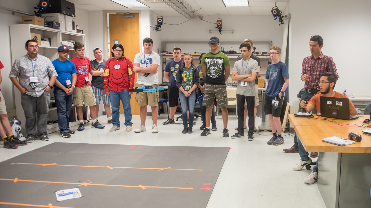 Student Salvador Alberto Figuerola Chaparro (right) demonstrates manual flight to students attending the STEM summer camp.   To learn more about our STEM summer camps, click here: http://sci.tamucc.edu/ENGR/stemsi/