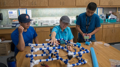 Roman Pena (left), Meagan Saylob, and Vincent Nguyen apply tape to PVC pipe in the Pipe ROV Building workshop during the Summer STEM camp.  To learn more about our STEM summer camps, click here: http://sci.tamucc.edu/ENGR/stemsi/