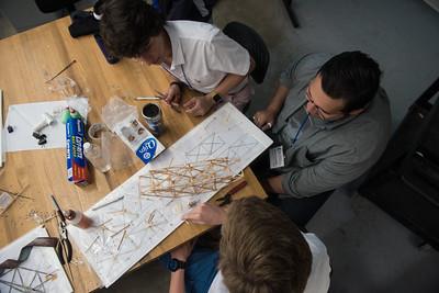 Bryan Edmonds(Left), Israel Cervantes, and Andrew Mistele. Work together on their model bridge during STEM Camp on June, 30, 2017