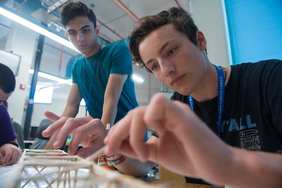 Joshua Mistele and Jonathan Gonzalez work on there model bridge during STEM Camp on June, 30, 2017