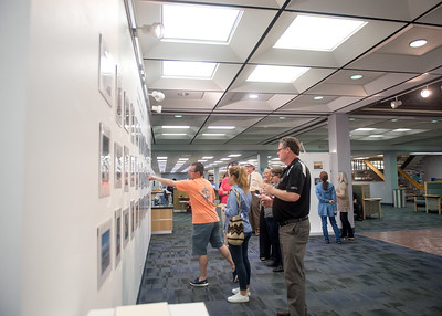 Students and staff view images submitted for the Second Islander Cell Phone Photography Show.