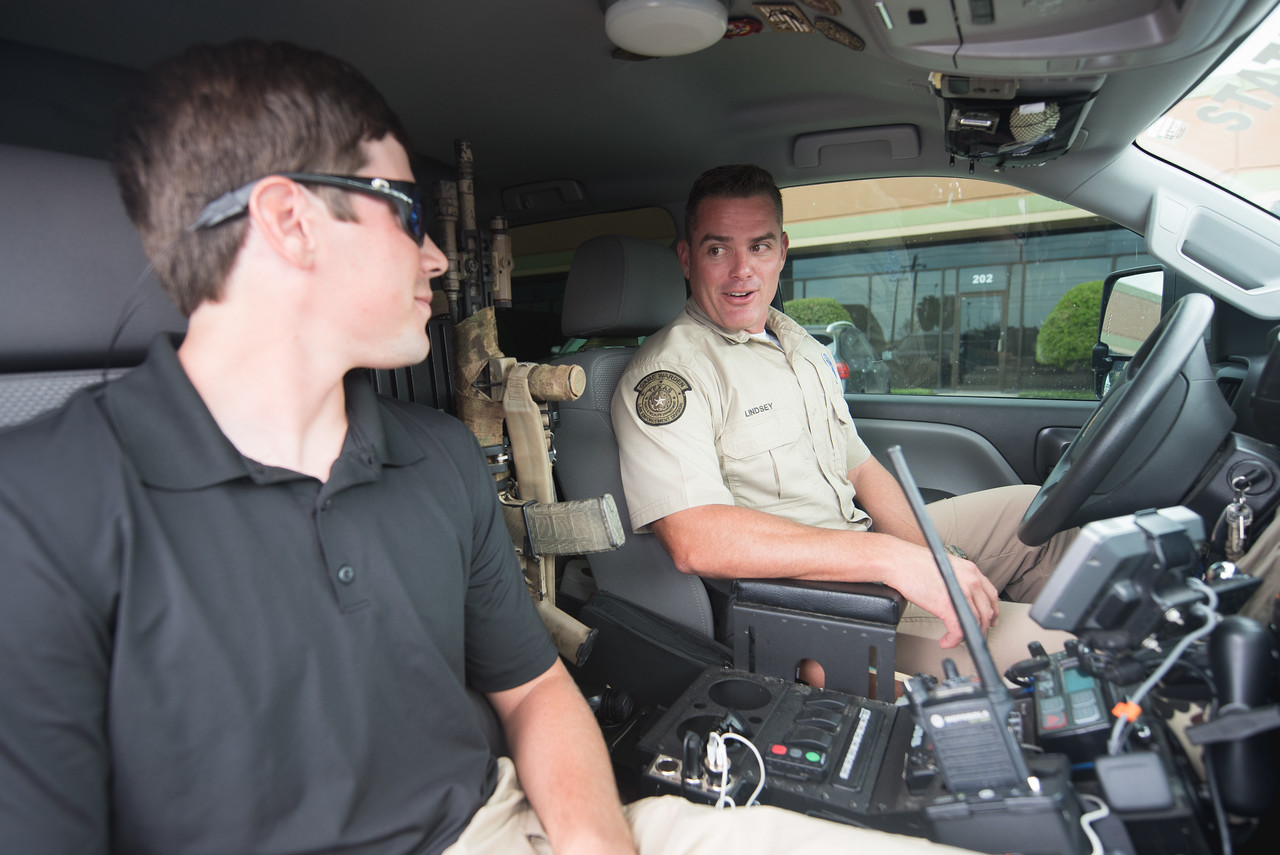 TAMU-CC student intern Reid Dunagan prepares for a ride along with game warden Jimmy Lindsey.