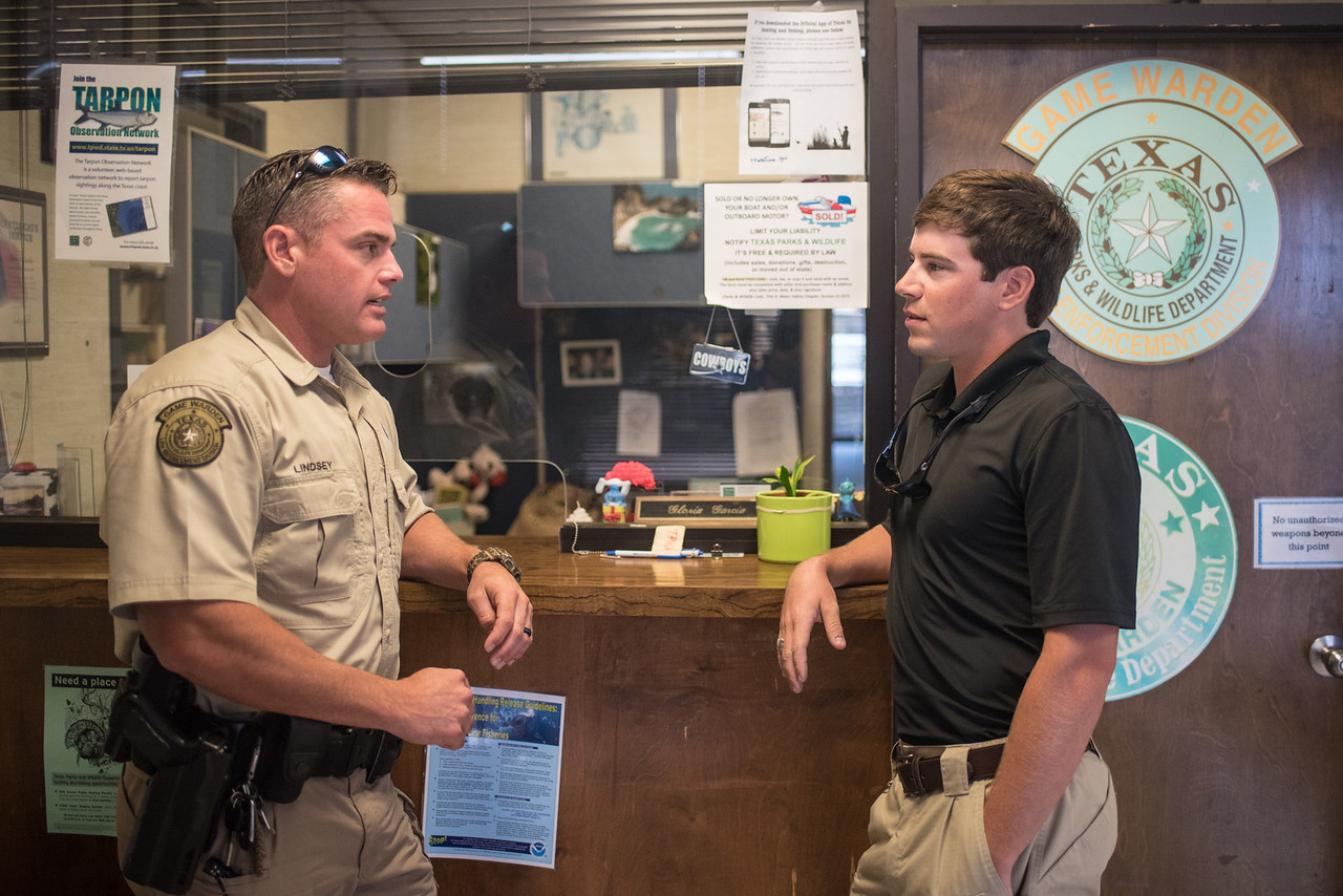 Game Warden Jimmy Lindsey (left) and TAMU-CC student intern Reid Dunagan meet up at the Texas Parks and Wildlife office to depart on a ride along.