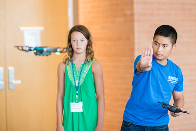TAMU-CC student Vincent Nguyen (right) teaches camper Nora Wold how to operate the DJI Maverick Pro during the 2017 Summer UAS Camp.