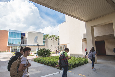 Students exit the Center for Instruction during the first day of fall semester.