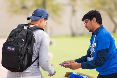 Sai Varun Polishetty (right) assists students as they arrive for their frist day of Fall Semester.