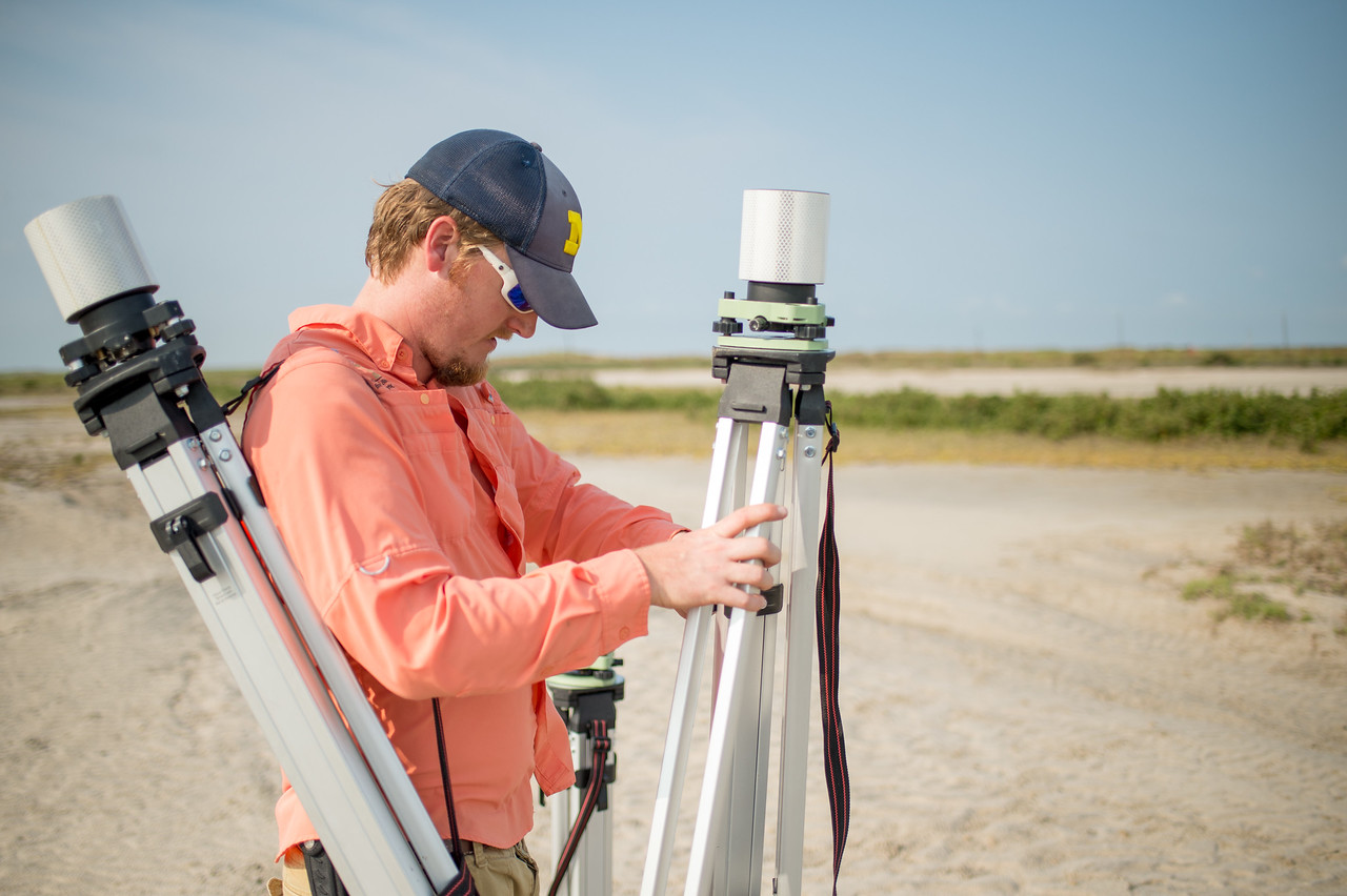 Brian Lorentson initializes GPS instruments during the CBI (Conrad Blucher Institute) survey of Mustang Island.