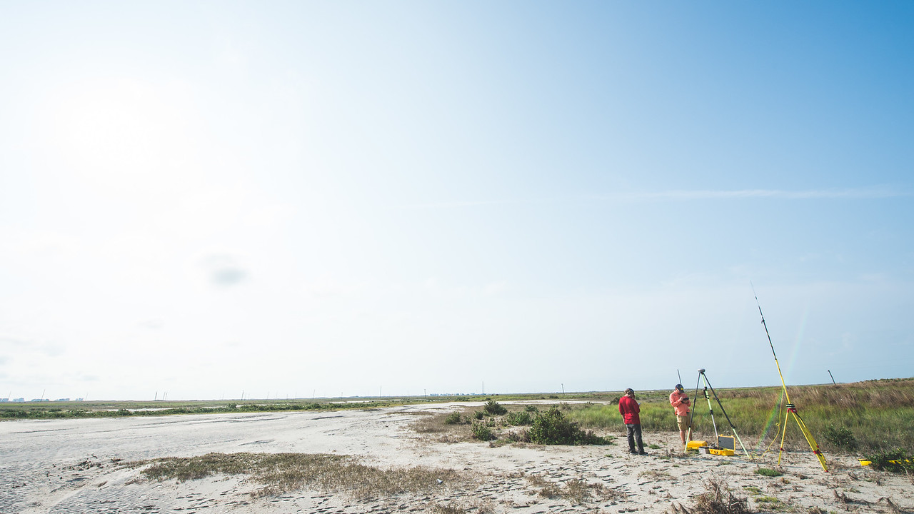 Alistair Lord (left) and Brian Lorentson install one of several instruments used during the survey of the Mustang Island area  The Conrad Blucher Institute  collects data following Hurricane Harvey's impact in the coastal bend.