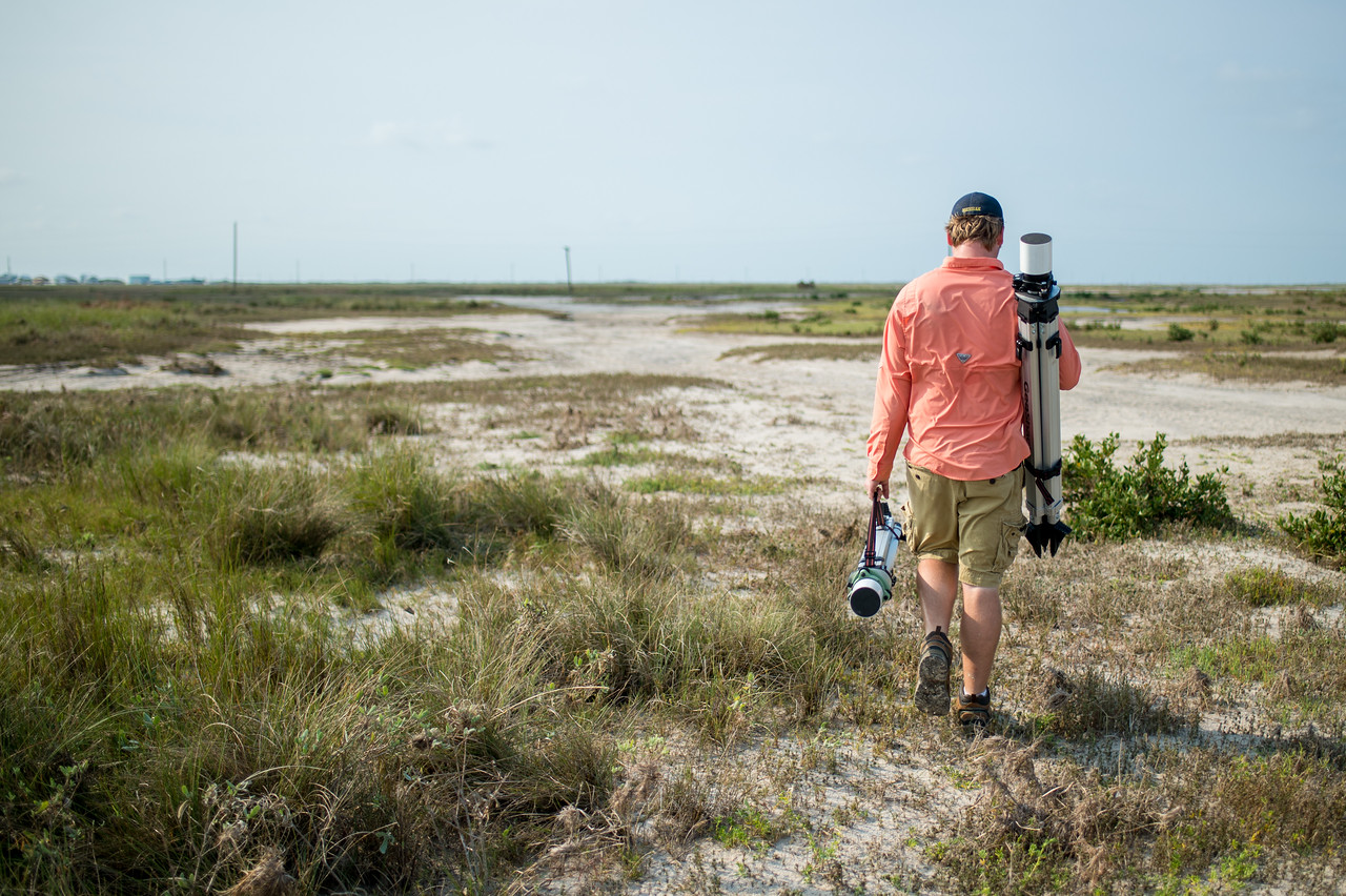 TAMU-CC's Conrad Blucher Institute, Brian Lorentson sets out to install one of several GPS instruments used to survey the Mustang Island area following Hurricane Harvey.