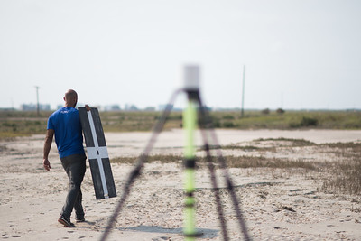 Yeoshua Cohen sets out to position a marker during the Conrad Blucher Institute's survey of Mustang Island.