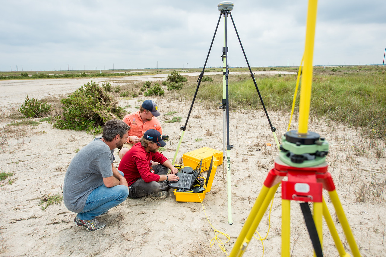 Conrad Blucher Institute for Surveying & Science researchers Jake Berryhill (left), Alistair Lord, and Brian Lorentson (back) collect data at the Mustang Island marshes following Hurricane H ...