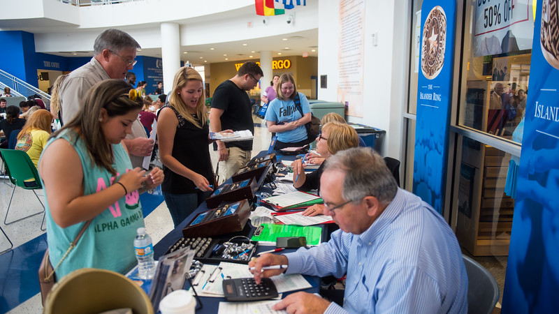 Students stop by the Islander Ring Sale in front of the Barnes & Noble at TAMUCC.