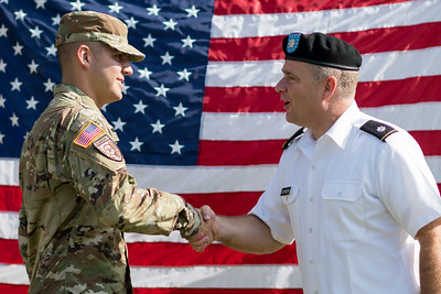 Cade Luke (left) and LTC Johnson during Luke's swearing-in ceremony on East Lawn for the Islander Battalion ROTC.