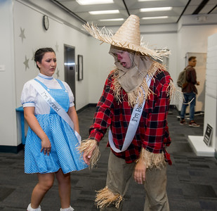 Student Wendy Ruisingev (left) and Luke Kasner in costume of Dorothy and Scarecrow for the Open House event in the time of Banned Book Week