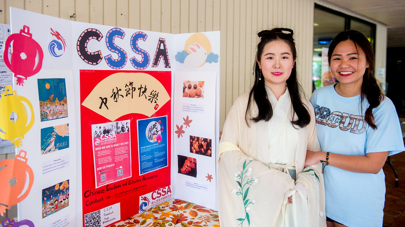 Student Xiaotian Tang (left) and Huong Nguyen at the table of Chinese Student & Scholars Association (CSSA)